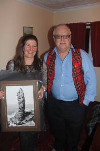 Sue the Team Leader of Assynt MRT with the photo of Stoer for THE Team. Thanks to Dave Tomkins for the photo it has gone to a good home. Photo Robert Kerr Assynt MRT.