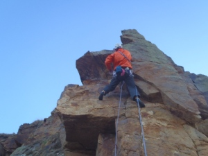 Pete trying daring deeds! At Cummingston, the sandstone can be a bit friable and care has to be taken.