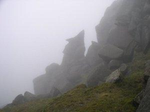 Great granite figures in the mist.