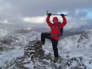 The enthusiastic Rachael battling the elements in Knoydart on Meall Bhuidhe som lassie. Photo Moray Mountaineering Club.
