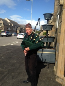 Patrick a real local character in Burghead piping in for the Coffee Morning