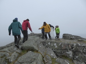 Helping hands at the top in the mist bags left out of the wind.