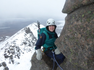 The weather clears on the belay and Mary enjoys the view.