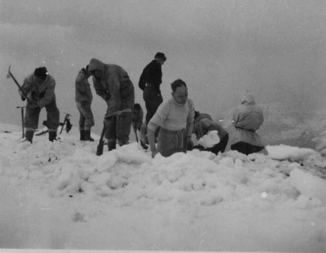 1951 The RAF Kinloss Team on the summit ridge digging out the wreckage. A grim task Photo Joss Gosling