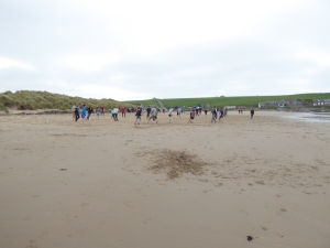 What a beach on the Moray Coast anyone name it? Lots of Surfers out an a family football better than the Scotland game.