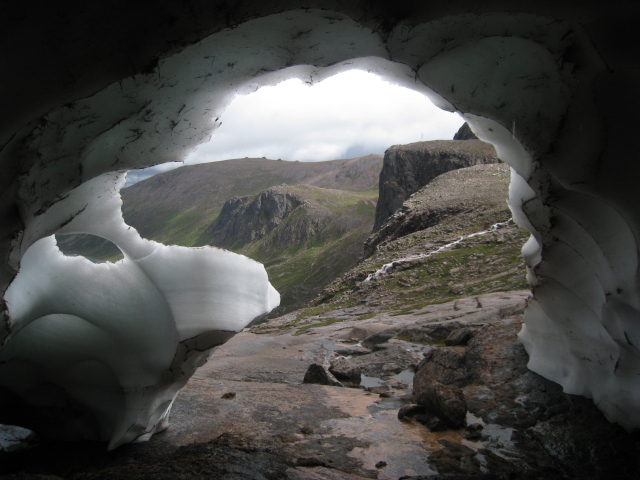 View out of entrance of ice tunnel on Feith Buidhe slabs, Ben Macdui, Cairngorms