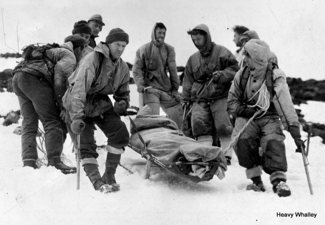 A gradual descent of the stretcher party, with the 'victim', their NCO Sgt Jones. The sledge runners of the stretcher are portable and quickly detached. Aberdeen Journals - 1952