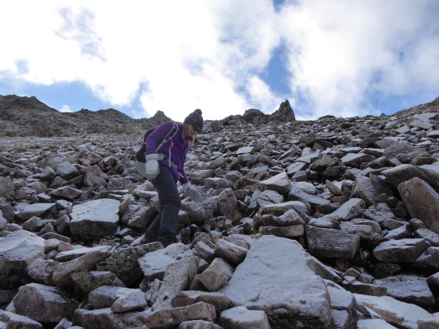 Descending the steep scree.