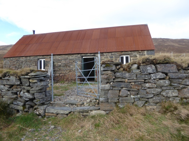 The bothy was in great condition and we sat outside for a break looking at the big pull up through the moors onto the Fannich.