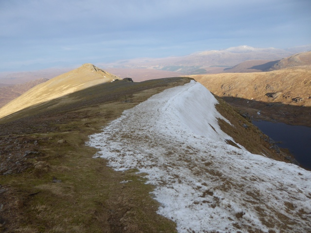 The dirty snow on the ridge was bullet hard and the turf solid but so little snow.