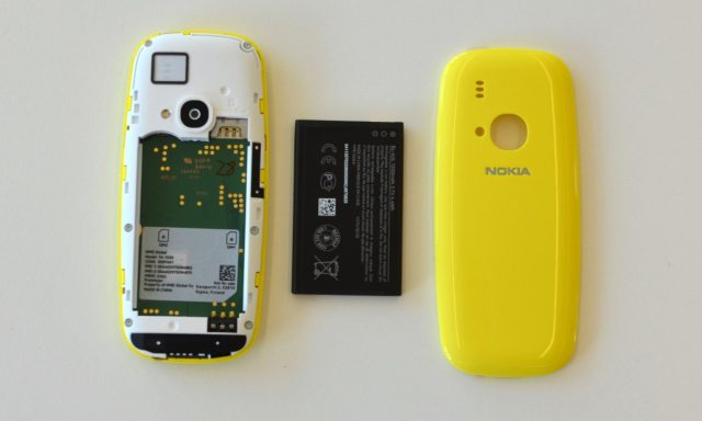 The back comes off, the battery comes out and there's even a microSD card slot. Photograph: Samuel Gibbs for the Guardian